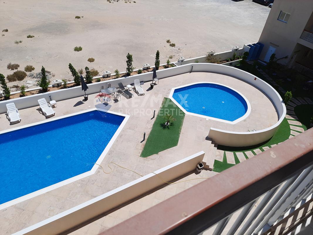 Pool facing   1 month free   4 Payments   Sandhurst - Sandhurst House, Jumeirah Village Circle, Dubai